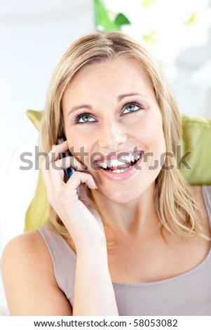 Animated caucasian woman talking on phone in the living room