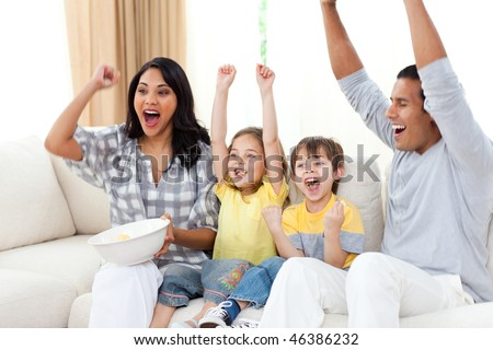 Animated family watching TV on sofa in the living room
