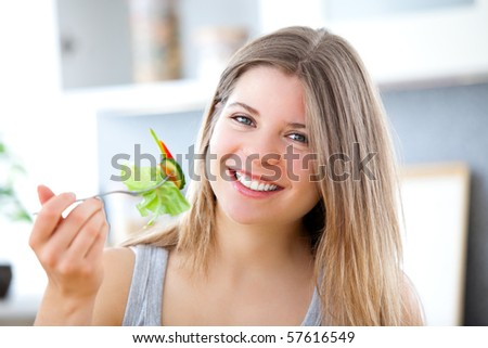 Animated woman eating a salad smiling at the camera