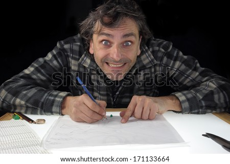 animator drawing on light box - stock photo