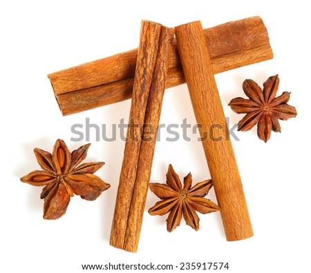 Anise and cinnamon isolated on white - stock photo