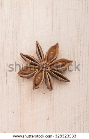 Anise star on white wooden background