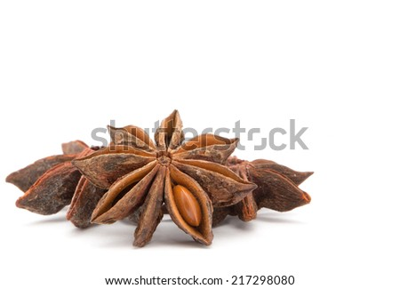 Anise stars on a white background - stock photo