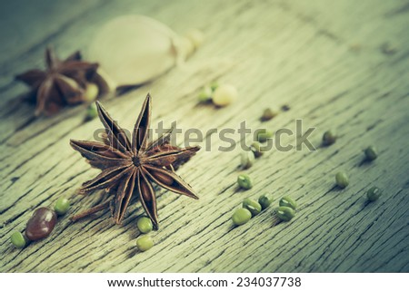 Anise stars on wooden background - stock photo