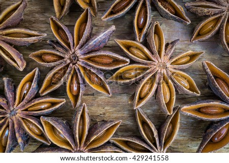 Anise stars on wooden brown background. Macro shot - stock photo