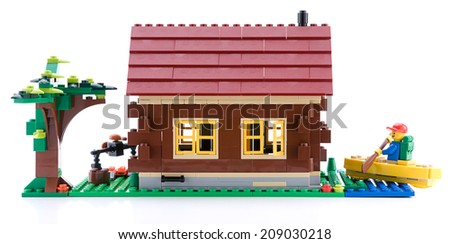 Ankara, Turkey - April 15, 2012: Lego Creator - Log Cabin is a 3 in 1 countryside houses isolated on white background - stock photo