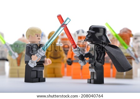 Ankara, Turkey - April 06, 2013: Lego Star Wars Darth Vader and Luke Skywalker are fighting with sword in front of Star Wars minifigures - stock photo
