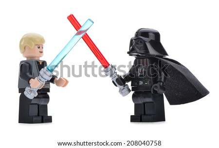 Ankara, Turkey - April 06, 2013: Lego Star Wars minifigure Darth Vader and Luke Skywalker are fighting with sword in front of other Star Wars characters isolated on white background. - stock photo
