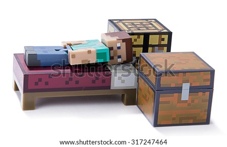 Ankara, Turkey  July 01, 2015: Minecraft figure Herobrine sleeping isolated on white background.  Minecraft is a game about breaking and placing blocks.   - stock photo