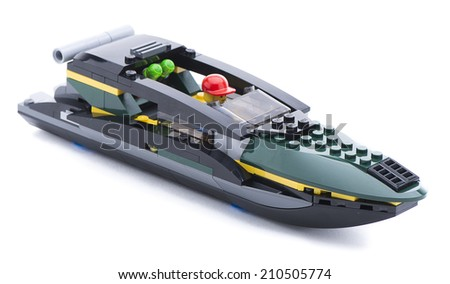 Ankara, Turkey - July 18, 2013: Studio shot of a Lego boat with captain isolated on white background