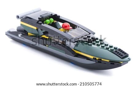 Ankara, Turkey - July 18, 2013: Studio shot of a Lego boat with captain isolated on white background  - stock photo