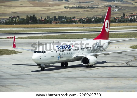 ANKARA, TURKEY - july  7, 2013: Turkish Airlines aircraft parked in Esenboga Airport, Turkish Airline is the fastest growing airline company of Europe - stock photo