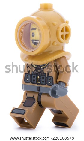 Ankara, Turkey - June 16, 2013 :  Lego minifigure of an ancient sponge diver with helmet walking isolated on white background. - stock photo