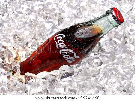ANKARA - TURKEY - June 1, 2014 250ml Classic Coca-Cola bottle with ice. Coca-Cola Company is the most popular market leader in Turkey. - stock photo