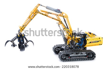 Ankara, Turkey - October 27, 2013:  Lego technic excavator isolated on white background. - stock photo