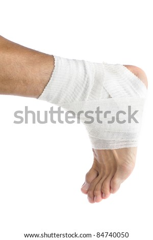 Ankle of male athlete wrapped in white bandages