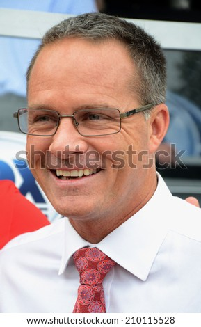 ANN ARBOR, MI - AUGUST 2:  Fox Soccer Channel analyst Eric Wynalda  poses during a break in the Fox broadcast of the International Champions Cup game on August 2, 2014 in Ann Arbor, MI. - stock photo