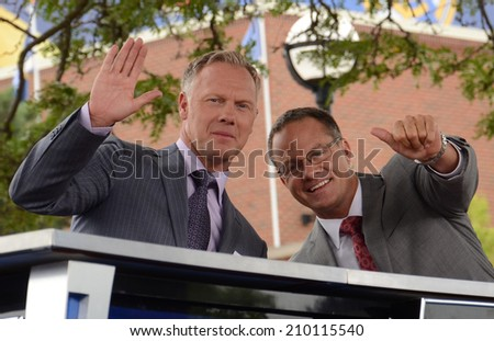 ANN ARBOR, MI - AUGUST 2:  Fox Soccer Channel analysts Warren Barton and Eric Wynalda  wave prior to their broadcast of the International Champions Cup game on August 2, 2014 in Ann Arbor, MI. - stock photo