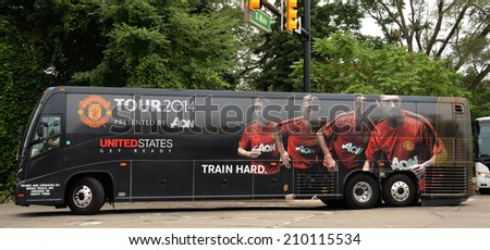 ANN ARBOR, MI - AUGUST 2:  Manchester United's team bus arrives for their game against Real Madrid as part of the International Champions Cup on August 2, 2014 in Ann Arbor, MI. - stock photo