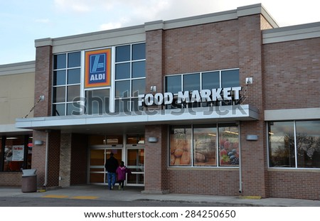 ANN ARBOR, MI - DECEMBER 30: Aldi, whose Canton grocery store sign is shown on December 30, 2014, has over 1200 locations.  - stock photo