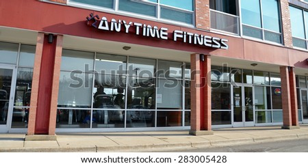 ANN ARBOR, MI - DECEMBER 22:  Anytime Fitness, whose north Ann Arbor gym is shown on December 22, 2014, has over 2,700 locations. - stock photo