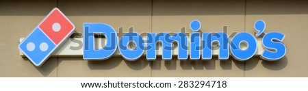 ANN ARBOR, MI - DECEMBER 22: Domino's, whose north Ann Arbor store logo is shown on December 22, 2014, has over 11,000 locations.  - stock photo
