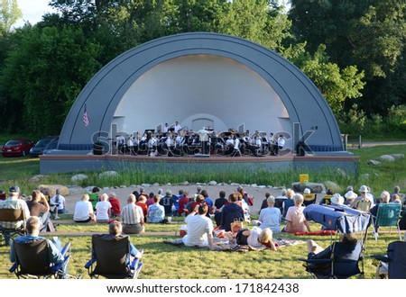ANN ARBOR, MI - JULY 24: Ann Arbor Civic Band performs at the West Park Band Shell in Ann Arbor July 24, 2013. The Civic Band was founded in 1935.  - stock photo