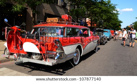 ANN ARBOR, MI - JULY 13: 1957 Buick Callabro 4 door wagon at the Rolling Sculpture car show July 13, 2012 in Ann Arbor, MI. - stock photo
