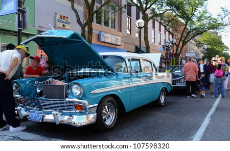 ANN ARBOR, MI - JULY 13: 1965 Chevrolet at the Rolling Sculpture car show July 13, 2012 in Ann Arbor, MI. - stock photo