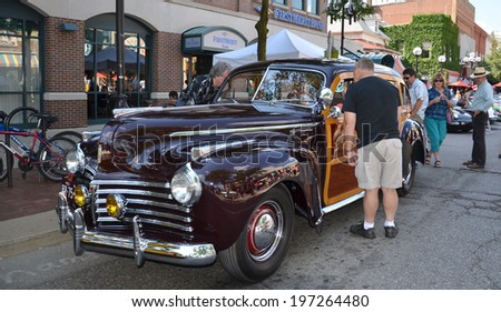 ANN ARBOR, MI - JULY 12: 1941 Chrysler Town and Country at the Rolling Sculpture car show  July 12, 2013 in Ann Arbor, MI - stock photo
