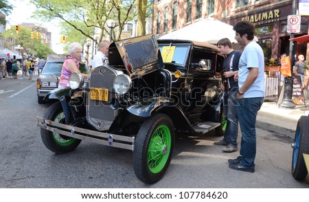 ANN ARBOR, MI - JULY 13: 1930 Ford Model A Victoria at the Rolling Sculpture car show July 13, 2012 in Ann Arbor, MI. - stock photo