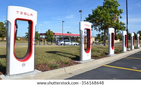 ANN ARBOR, MI - OCTOBER 10: The Tesla Supercharger station in Ann Arbor, MI, shown here on October 10, 2015, can provide 170 miles of charge in 30 minutes. - stock photo