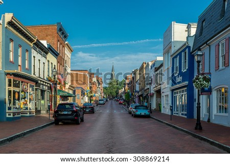 ANNAPOLIS, MARYLAND - JULY 19: Main Street with St. Anne's Church in the background on July 19, 2015 in Annapolis, Maryland  - stock photo
