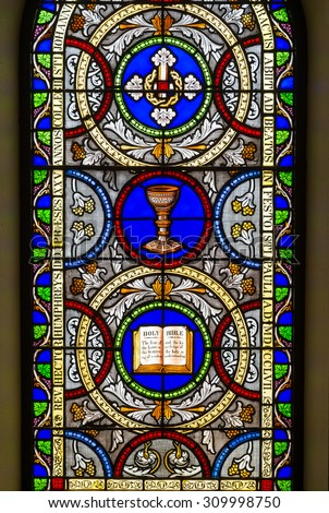 ANNAPOLIS, MARYLAND - JULY 17:  Stained glass window in St. Anne's Episcopal Church on Duke of Gloucester Street on July 17, 2015 in Annapolis, Maryland - stock photo