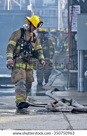 ANNAPOLIS, MD - DECEMBER 12: Annapolis fire department working hard to put out a fire at the Annapolis Yacht Club on December 12, 2015 in Annapolis.