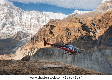 Annapurna Base Camp, Nepal - Nov 29:Rescue helicopter evacuates mountain climbers after accident from Annapurna Base Camp, Nepal on November 29, 2013. - stock photo