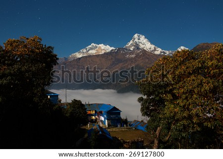 Annapurna I Himalaya Mountains View from Poon Hill 3210m at night with stars - stock photo