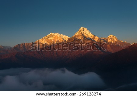 Annapurna I Himalaya Mountains View from Poon Hill 3210m at sunset - stock photo