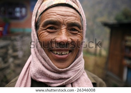 ANNAPURNA, NEPAL - MAR 18 : A portrait of happy porter who carries up to 80 kg on his back for up to 10 days in the Himalayas on March 18, 2008 in Annapurna, Nepal.