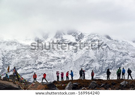 ANNAPURNA - OCT 3: Annapurna climbing expeditions forced to stay in the ABC, without any possibilities to reach the summit, due to bad weather. On Oct 8, 2013 in Annapurna Base Camp, Himalayas, Nepal - stock photo