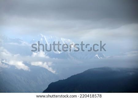 Annapurna range through the clouds - stock photo