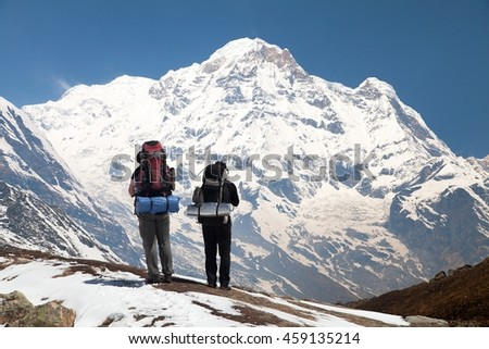 Annapurna south from mount Annapurna base camp with two tourists, Nepal
