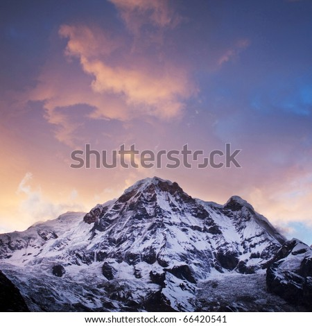 Annapurna South peak sunset - view  from Annapurna Base Camp in Central Nepal - stock photo