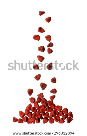 Annatto seeds isolated on white background - stock photo