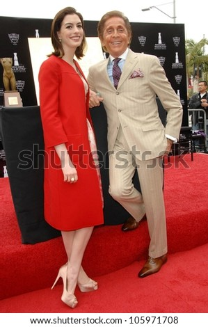 Anne Hathaway and Valentino Garavani  at the Rodeo Drive Walk of Style Ceremony honoring Valentino Garavani. Rodeo Drive, Beverly Hills, CA. 04-02-09 - stock photo