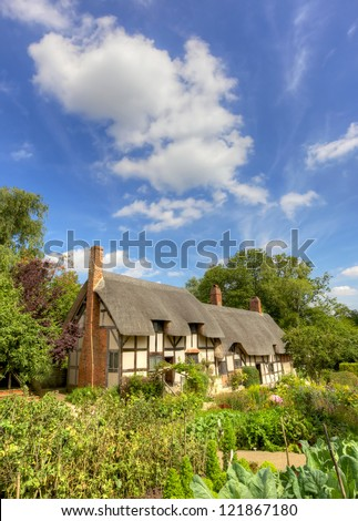 Anne Hathaway's (William Shakespeare's wife) famous thatched cottage and garden at Shottery, just outside Stratford upon Avon, England. - stock photo