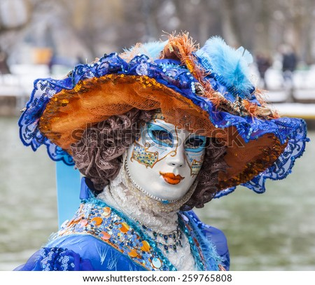 ANNECY,FRANCE- FEB 23:Portrait of an unidentified person disguised posing in Annecy,France,on February 23 2013.Every year here is held a Venetian Carnival to celebrate the beauty of real Venice