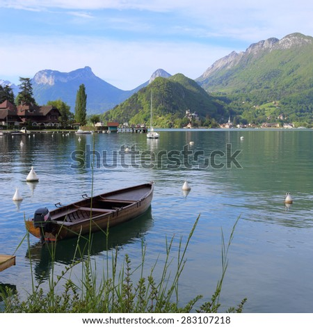 Annecy lake in the alps - stock photo