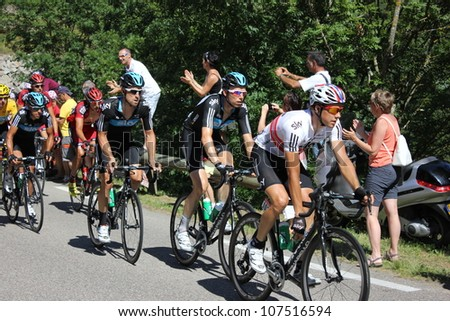 ANNONAY, FRANCE - JUL 13: Team Sky (Boassen-Hagen, Rogers, Porte) and Bradley Wiggins in stage 12 of Le Tour de France 2012. David Millar wins the race on July 13, 2012 in Annonay Ardeche, France - stock photo