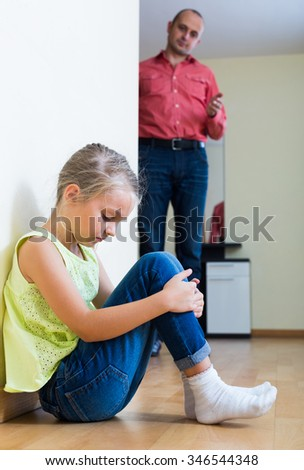 Annoyed father lecturing offended little daughter at home